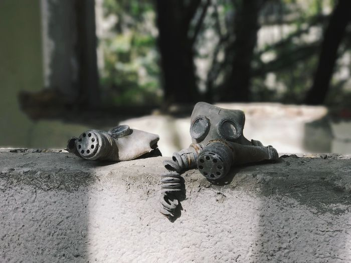 Close-up of gas masks on wall