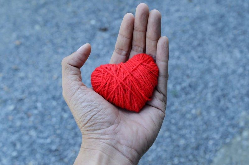 Cropped Hand Holding Heart Shape Wool