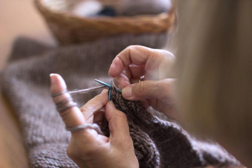 Adult Art And Craft Crafts Craftsman Craftsman Working Creativity Hands Knitting Hands Knitting Close Up Human Body Part Human Hand Knitt Knitted  Knitted Sweater Knitting Knitting Needle Knitting Project Knitting Wool Skill  Women Knitting Women Knitting Close Up Wool Wool Balls Woolen Woolen Yarn Working