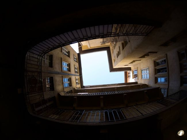 Architecture Building Built Structure Ceiling Courtyard  Day Directly Below History Indoors  Low Angle View Nature No People Old Railing Residential District Sky Skylight Staircase Steps And Staircases Sunlight Window