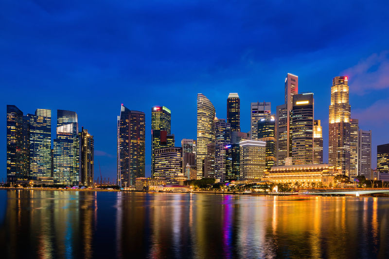 Singapore illuminated Singapore Architecture Building Building Exterior Built Structure City Cityscape Financial District  Illuminated Landscape Long Exposure Modern Nature Night No People Office Building Exterior Outdoors Reflection Sky Skyscraper Tall - High Travel Destinations Urban Skyline Water Waterfront