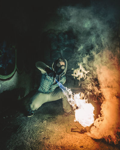Flames HUAWEI Photo Award: After Dark Burning Clothing Digital Composite Fire Fire - Natural Phenomenon Full Length Gas Mask Heat - Temperature Indoors  Leisure Activity Motion Nature One Person Real People Sign Smoke - Physical Structure Spooky Warning Sign Young Adult Young Men