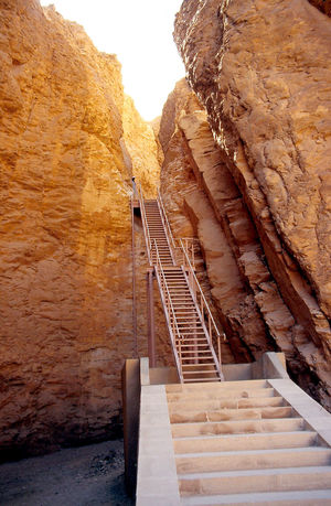 Modern staircase to the Tomb of Tutmoses - Valley of the Kings, Luxor, Egypt Luxor,Egypt Tomb Of Tutmoses Architecture Beauty In Nature Cliff Day Geology Mountain Nature No People Outdoors Rock - Object Rock Face Rock Formation Sky Steps Steps And Staircases Travel Destinations Valley Of The Kings