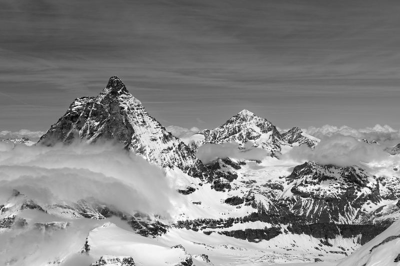Matterhorn and other peaks with clouds Alpen Beauty In Nature Black And White Zermatt Clouds And Sky Matterhorn  Peak Snowcapped Mountain Suisse  Travel Valais Landscapes Monochrome Photography Mountain
