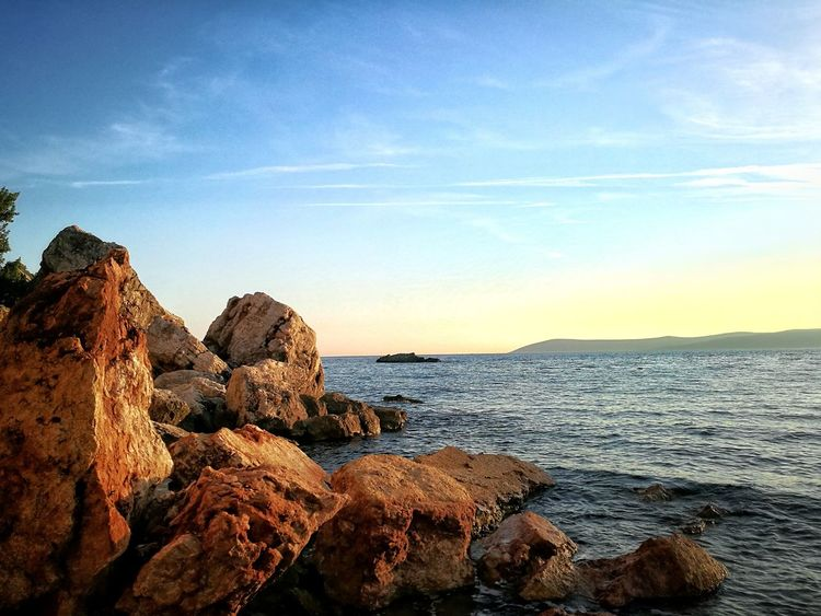 Rocky beach Sea Beach Nature Horizon Over Water Rock - Object Water Outdoors Sky Scenics Tranquility Beauty In Nature No People Sunset Travel Destinations Blue Sand Vacations Day Smartphonephotography Beauty In Nature Nature Summer