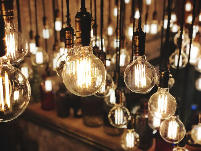 Lighting Lighting Equipment Illuminated Hanging Indoors  Electricity  Light Bulb Glass - Material Focus On Foreground No People Close-up Glowing Light Electric Light Night Shiny Decoration Bar - Drink Establishment Pendant Light Group Transparent