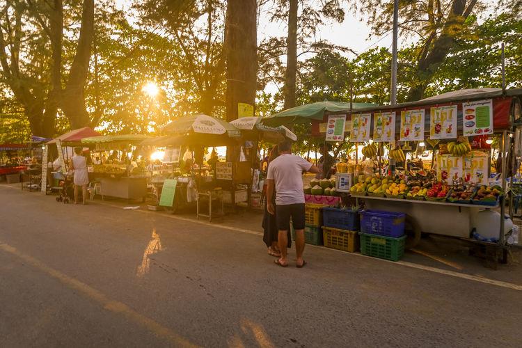 People walking in market stall