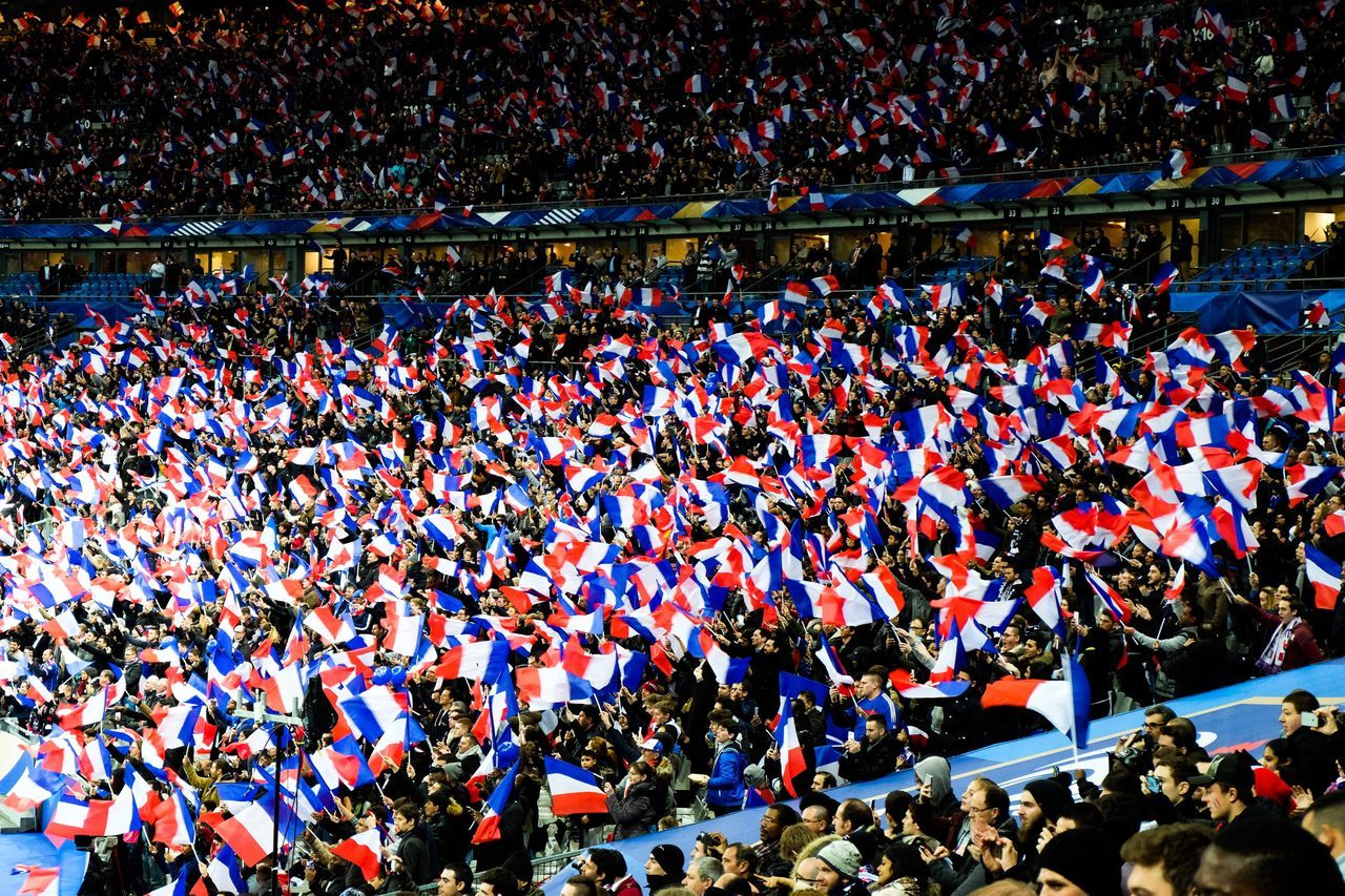 French audience with flags in soccer stadium