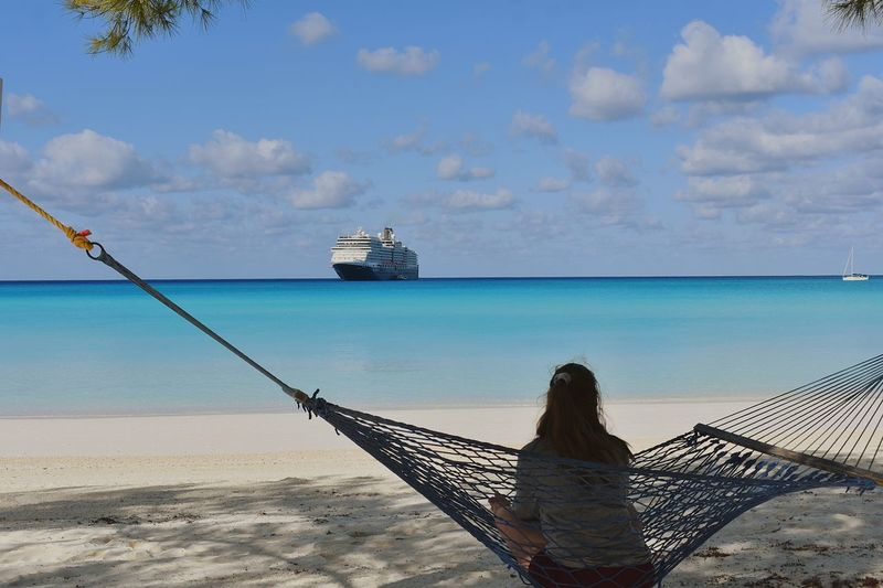 Relaxing day at the beach Cruise Water Nautical Vessel Sea Beach Sand Beauty Blue Sky Horizon Over Water Seascape Coast Island Bay Of Water Caribbean Sea Turquoise Colored Coastline Tide