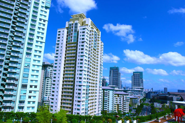 Architecture Blue Building Building Exterior Built Structure City City Life Cityscape Cloud Cloud - Sky Day Low Angle View Modern Residential Structure Sky Skyscraper Tall - High Tower SM Aura Taguig Philippines