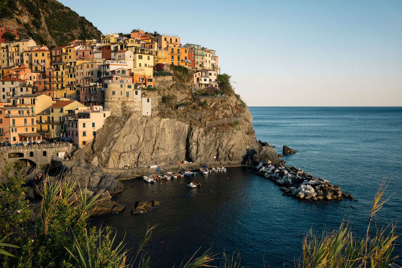 Architecture Cinque Terre Cinque Terre Liguria Clear Sky Famous Place Five Five Lands Horizon Over Water House Italy Landmark Manarola Mediterranean  Mediterranean Sea Riviera Rock Formation Sea Sunset Tourism Town Travel Traveling Village Warm Light Water