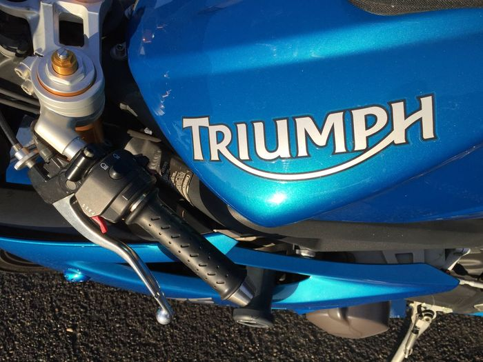 Triumph Daytona 675 left side logo and clip-on. 675 Blue Close-up Clutch Clutchbag Day Daytona Motorcycle No People Outdoors Sportbike Triumph