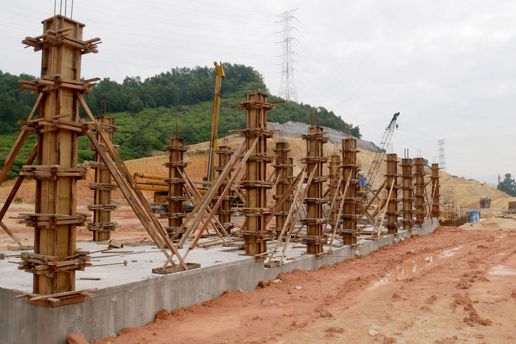 Construction site on field against sky
