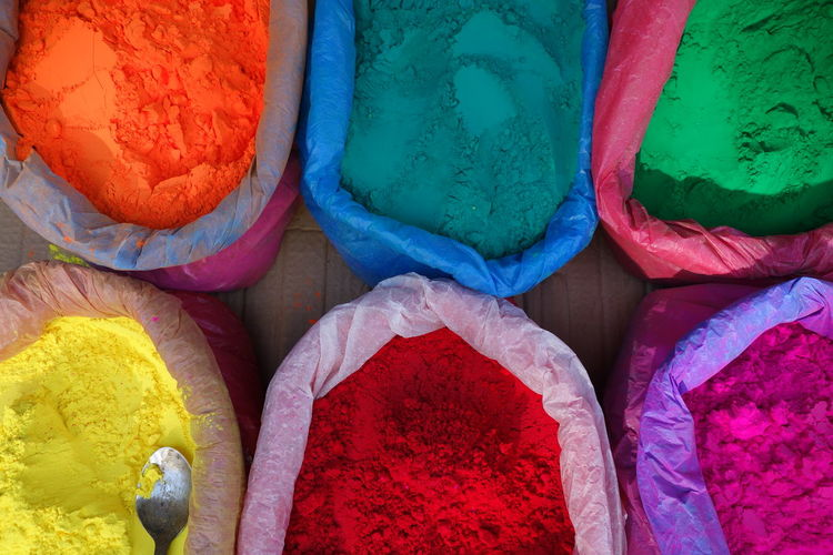 Directly Above Shot Of Color Powder In Sacks