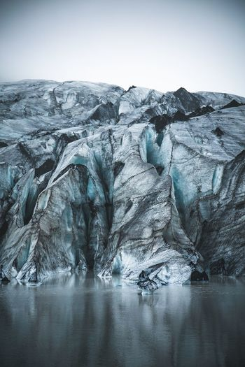 A glacier on its lake like an ice cube on your glass