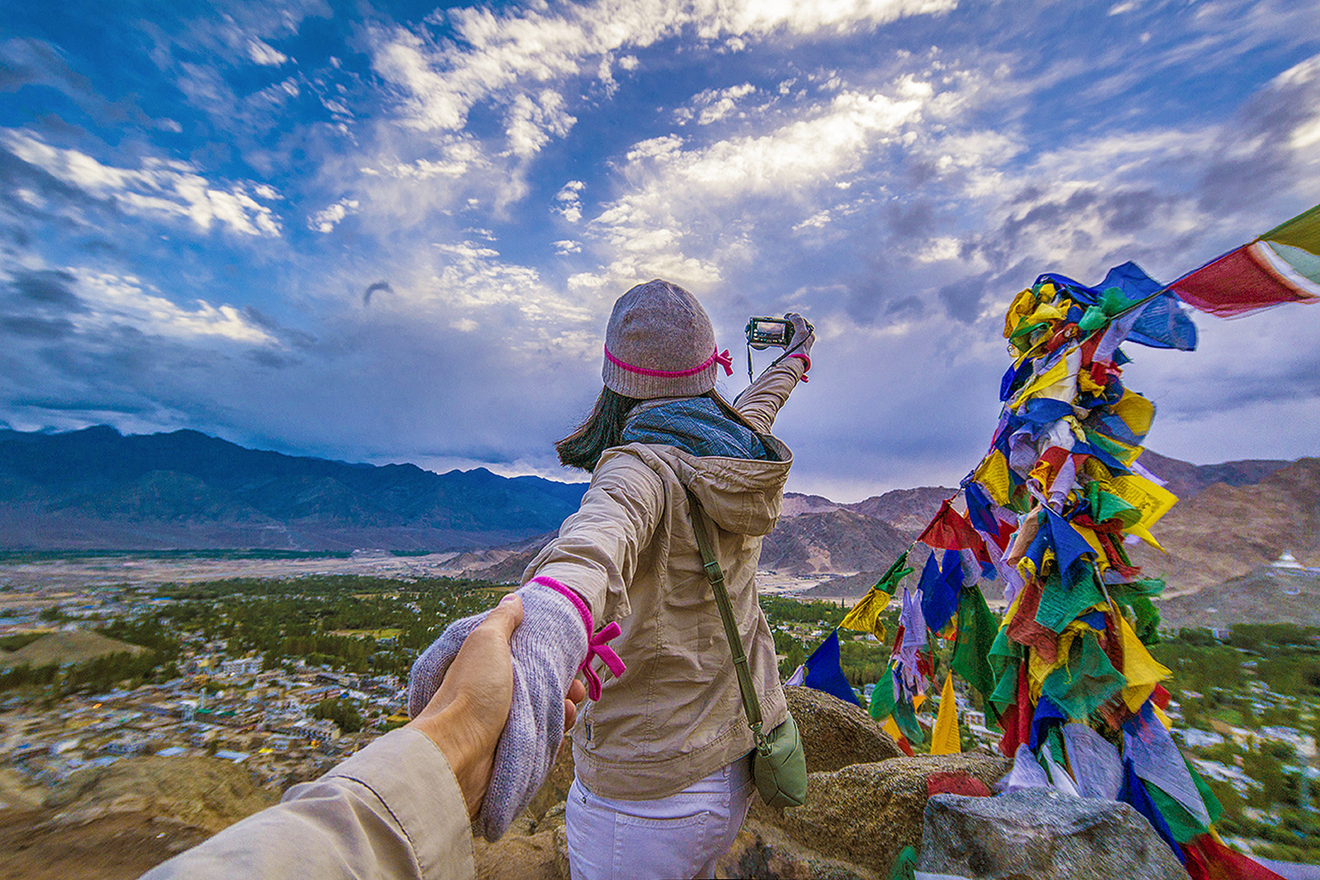 sky, lifestyles, cloud - sky, leisure activity, standing, casual clothing, full length, mountain, three quarter length, rear view, cloud, cloudy, young adult, men, outdoors, day, young women, person