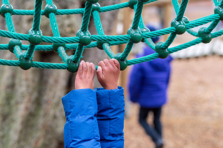 Hanging Playtime Rope Rope Bridge Child Climbing Frame Hand Holding On Holding On Tight Leisure Activity Outdoor Play Equipment Playground Playing Real People Moments Of Happiness