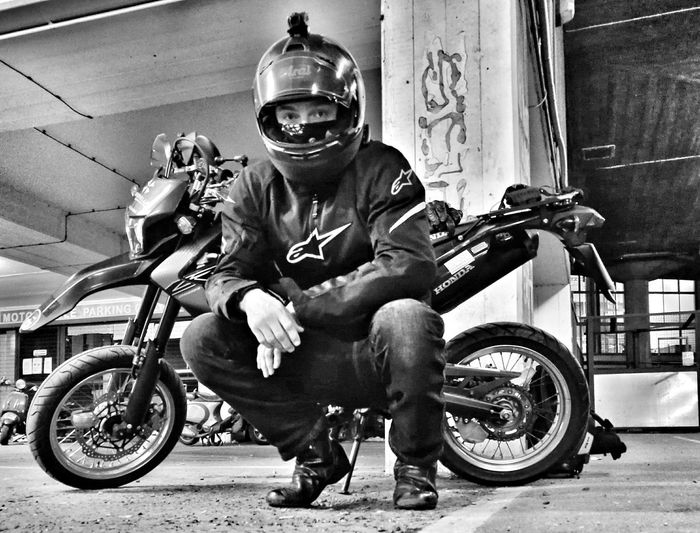 Motorcycle Rider, London, England Motorcycle Dirtbike Biker Biker Life Honda Crf250m Car Park Wheels Helmet Action Cam Protection Monochrome Photography TakeoverContrast Urban Scene London Huaweiphotography HuaweiP9 Contrast Gritty Picoftheday Men Person Kneeling Transportation City