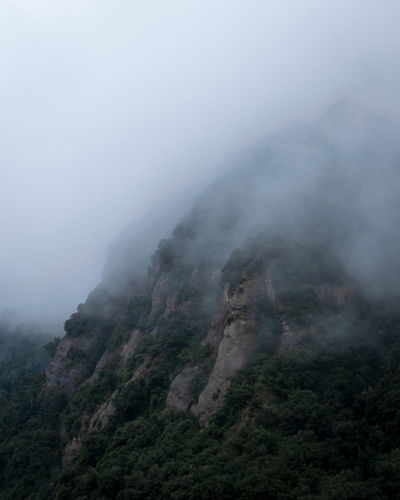 Scenic view of misty mountains.