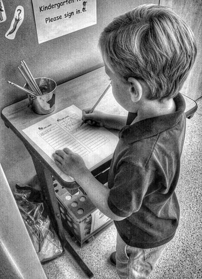 Child signing into schoolEyeEm Best Shots - Black + White Blackandwhite Photography EyeEm Best Shots Black And White Photography School Life  School Learning Child Photography Kids Kids Portrait Children Playing Boy Childhood Child Childhood Memories Children's Portraits Children Photography Boys Will Be Boys Children Children Only Education Black&white Educational Kids Being Kids Sign