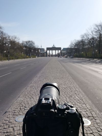 Close-up of camera on road against sky