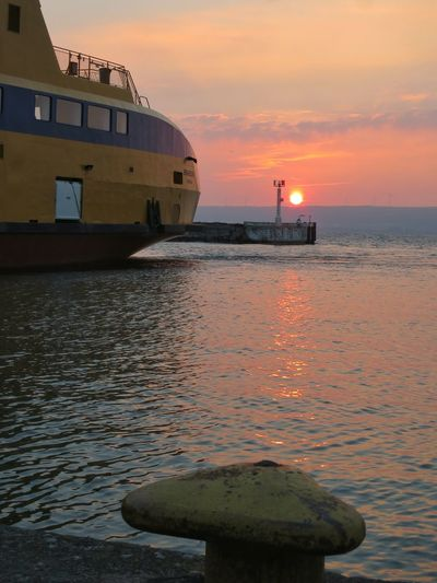 Water Orange Color Sun Morning Light Morning Sky Outdoors Harbour Ferry Commuting Cycling