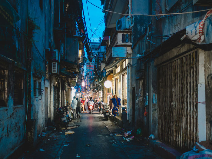 Building Exterior Architecture City Built Structure Street Illuminated Group Of People Direction Residential District Building The Way Forward Night Real People Market Incidental People Transportation People Men Women Outdoors Alley