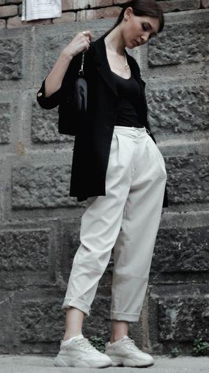 Full length of man walking against wall