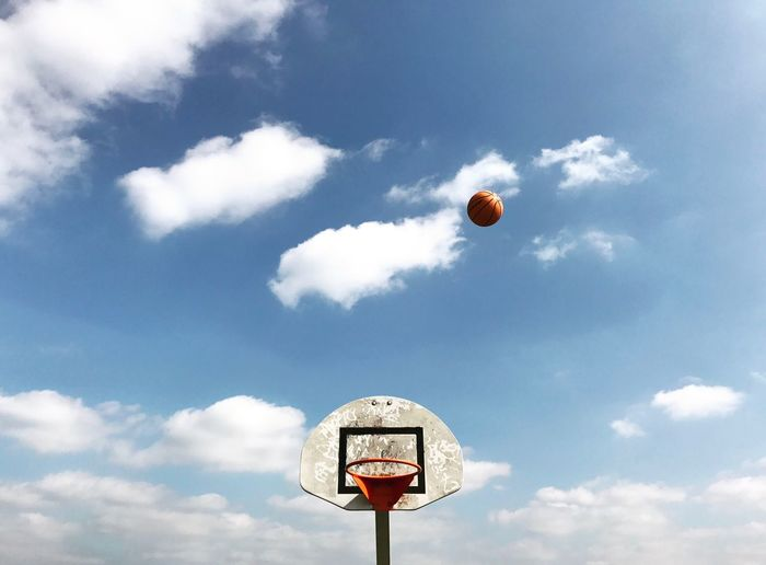 Sky Cloud - Sky Outdoors No People Day Nature Low Angle View Basketball Hoop Beauty In Nature Ball Basketball London IPhoneography Hoops Hoopdreams Basket Backboard Blue White Orange Fresh On Market 2017