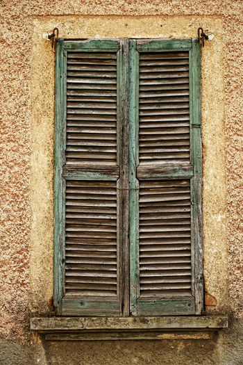 Window Built Structure Architecture Building Exterior Old Closed No People Day Wall - Building Feature Building Shutter Weathered House Security Safety Damaged Decline Run-down Abandoned Wall Outdoors Deterioration Window Frame