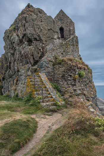 Channel Islands Elizabeth Castle, Jersey Ancient Ancient Civilization Architecture Building Building Exterior Built Structure Day Grass History Land Low Angle View Nature No People Old Old Ruin Outdoors Rock Rock - Object Ruined Sky Solid The Past