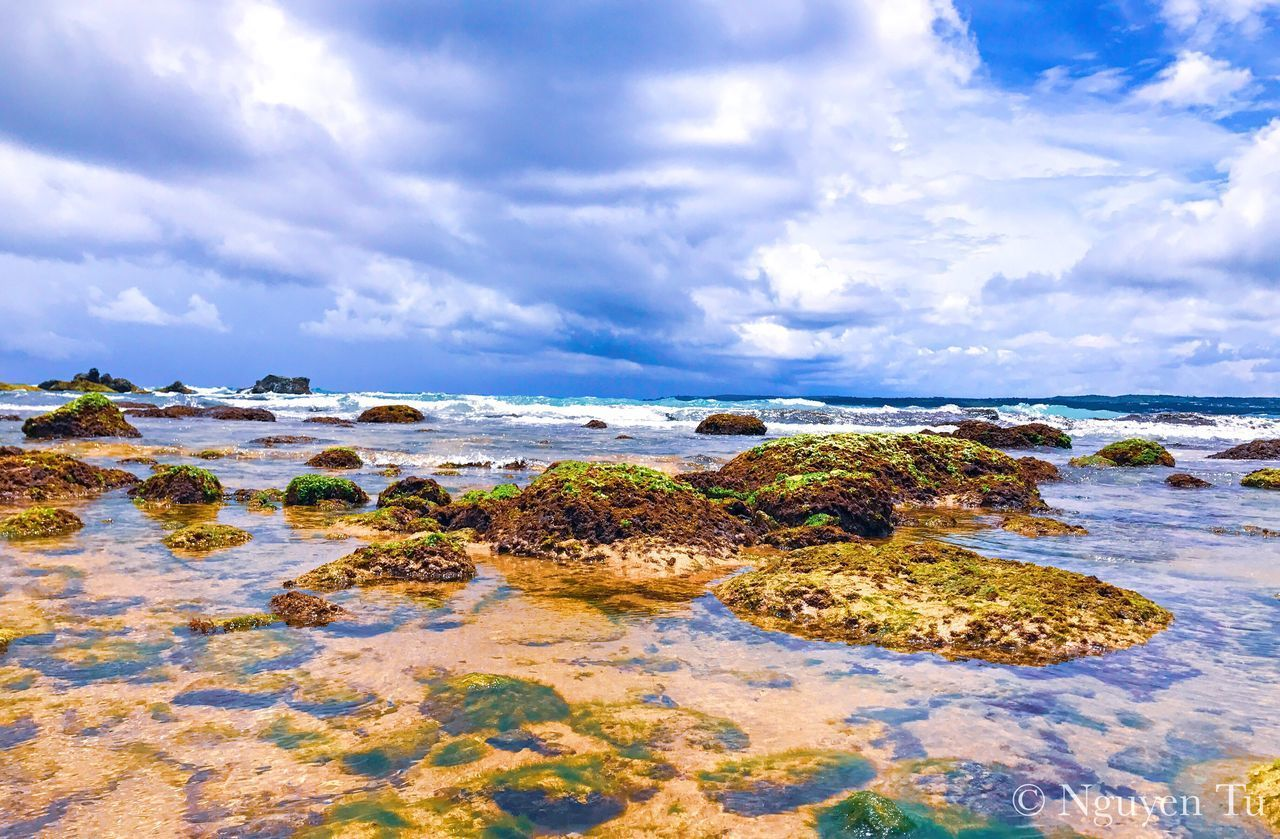 water, cloud - sky, sky, sea, beauty in nature, scenics - nature, tranquility, land, beach, tranquil scene, rock, nature, solid, horizon over water, rock - object, no people, day, horizon, motion, rocky coastline, shallow
