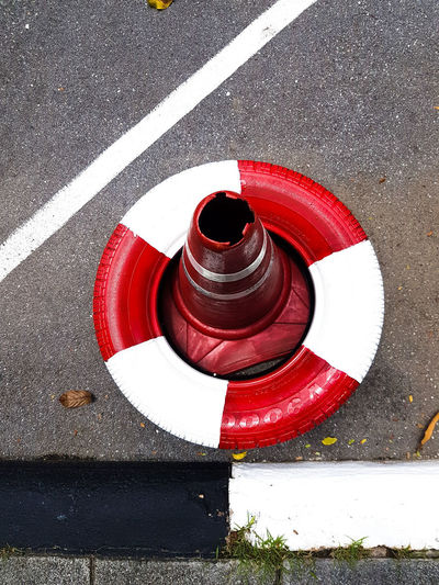 New angle Street Road Marking Black And White Red And White Red White Black Angles And Lines Angles Lines Diagonals Tyre Painted Tyre Block Of Colour Colour Blocks Stripes Patterns Interesting Perspectives Red Road High Angle View Protection Safety Street Close-up Traffic Cone EyeEmNewHere