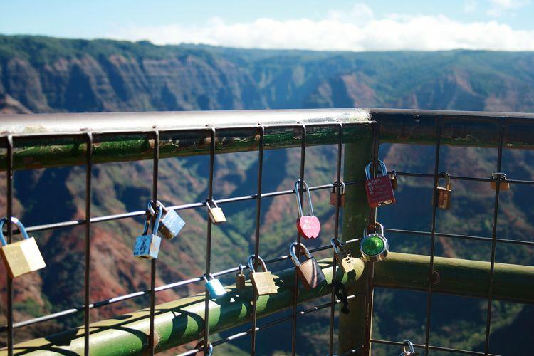 Love locks at railing by waimea canyon state park