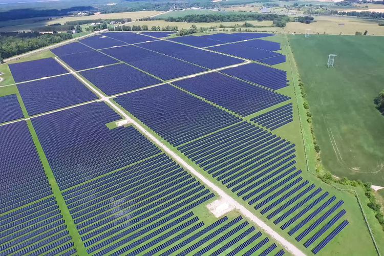 solar panels Environment Nature Day Fuel And Power Generation Aerial View Environmental Conservation Outdoors No People Renewable Energy Blue Technology Alternative Energy Green Color High Angle View Land Sunlight Solar Energy Landscape Airplane Water Power Supply Solar Panels