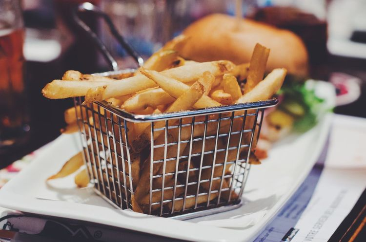Pommes frites Restaurant Served Burger Joint Pub Awesome Tasty Delicious Frites Pommes Food Food And Drink Potato Fried Prepared Potato Ready-to-eat Basket Unhealthy Eating Close-up Fast Food Container French Fries No People Focus On Foreground Indoors  Freshness Deep Fried  Snack Still Life