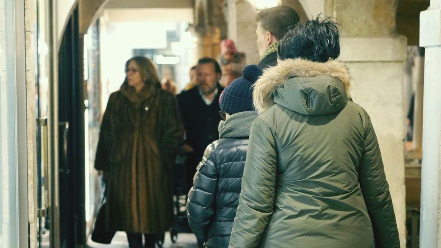 People walking in corridor during winter