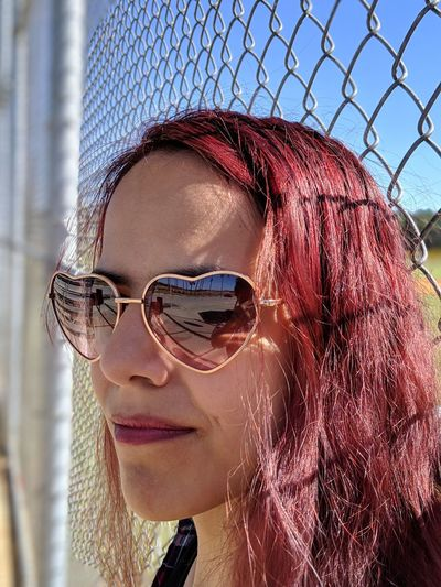 Dyed Red Hair Dyed Hair Sports Park Sunny Day Pixel 3 Xl Young Women Headshot Women City Eyeglasses  Chainlink Fence Close-up Sky Fence Chainlink Thoughtful Pensive Thinking Pretty
