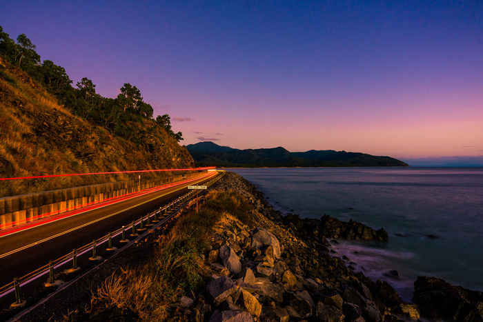 Need for speed 2 Beauty In Nature Clear Sky Eye4photography  Landscape Light Trail Light Trails Moving Motion Mountain Nature Roadtrip Outdoors Road Road Sign Scenics Sea Sky Stars Sunset The Great Outdoors - 2017 EyeEm Awards Tourism Tranquility Transportation Ocean Been There. Summer Exploratorium