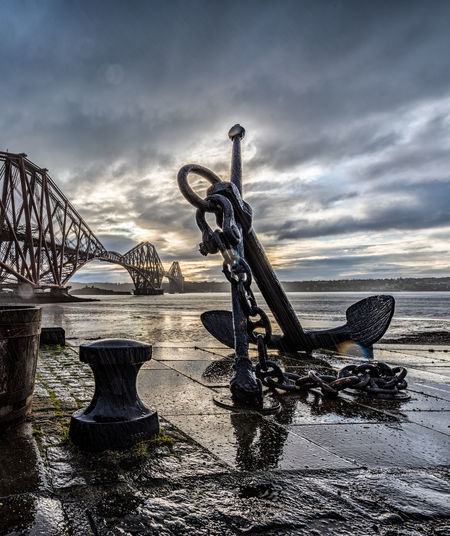 Cloud - Sky Sky Nature No People Water Bridge Bridge - Man Made Structure Connection Architecture Day Built Structure Land Sea Transportation Art And Craft Outdoors Travel Destinations Sculpture Anchor