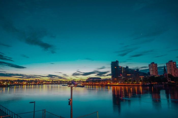 Scenics Teal And Orange Architecture Reflection Building Exterior Built Structure Night Dusk Illuminated Sky Water Skyscraper City Urban Skyline Modern Cloud - Sky Waterfront No People Outdoors Cityscape Tealandorange Sunset Tames
