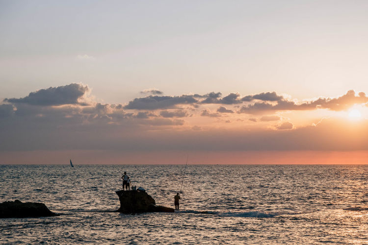 Fishermen by sunset in Acre, Israel Mediterranean  Travel Acre Beauty In Nature Cloud - Sky Day Fisherman Fishermen Horizon Over Water Israel Nature Outdoors Sailing Scenics Sea Silhouette Sky Sun Sunlight Sunset Tourism Tranquil Scene Tranquility Travel Destinations Water EyeEmNewHere