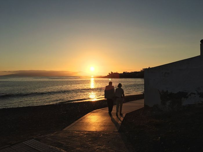 Sunset Sea Beach Two People Togetherness Full Length Silhouette Scenics Water Real People Nature Men Beauty In Nature Leisure Activity Horizon Over Water Sky Lifestyles Sun Outdoors Sunlight Waterfront Tranquil Scene Tranquility Summer Tenerife Sommergefühle