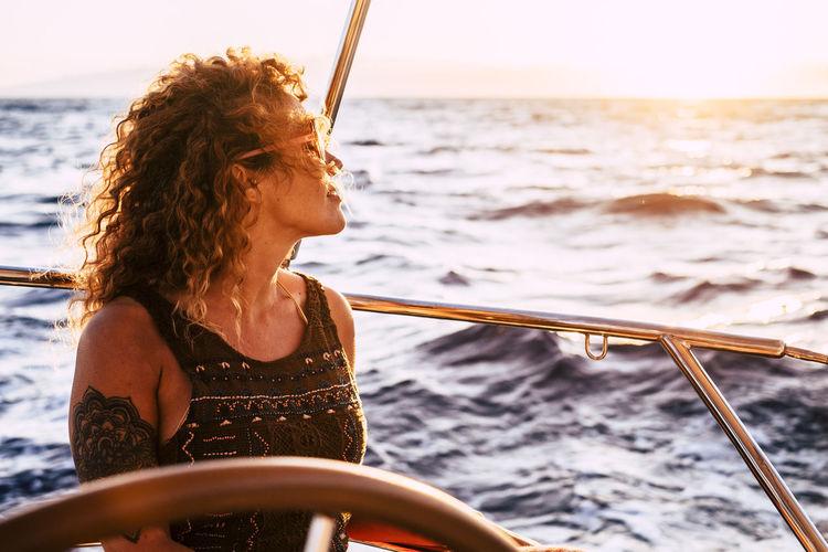 Woman looking at sea seen through boat
