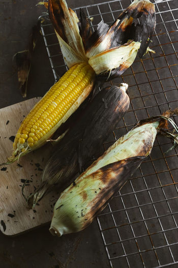 High angle view of roasted corns on cooling rack