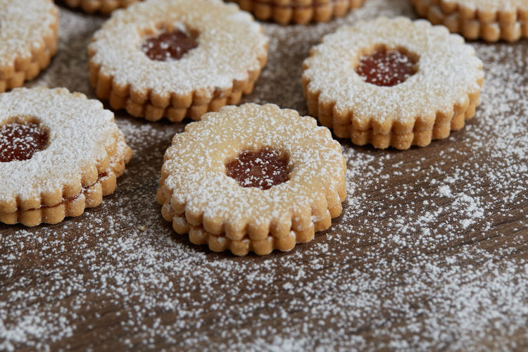 Close up of freshly baked homemade Christmas sugar cookies with jam Sweet Food Food Food And Drink Sweet Dessert Baked Indulgence Freshness Temptation No People Indoors  Cake Close-up Unhealthy Eating Still Life Large Group Of Objects Ready-to-eat Baked Pastry Item Sugar Cookie Powdered Sugar Snack Cupcake Holder Homemade Freshness Jam Freshly Baked Freshly Cookies