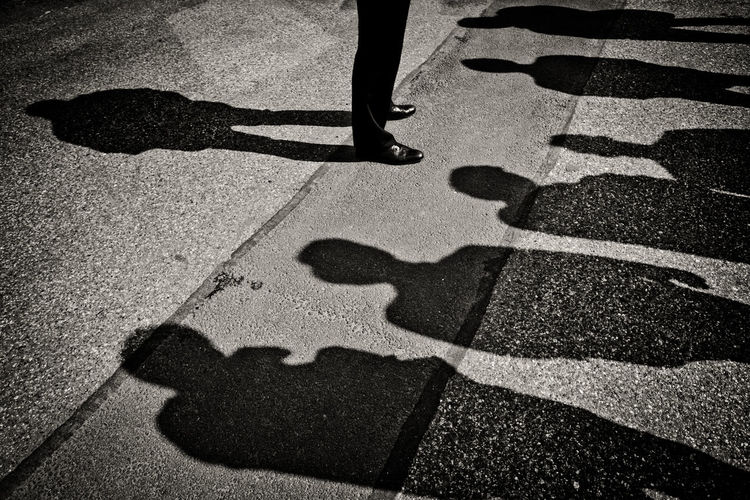 Guiding The Week On EyeEm Black And White Briefing Bw Day Focus On Shadow Group Group Of People Guide Human Body Part Human Leg Lecture Men Only Men Outdoors People Real People Road Shadow Shoe Standing Sunlight Surrounding Urban Adventures In The City