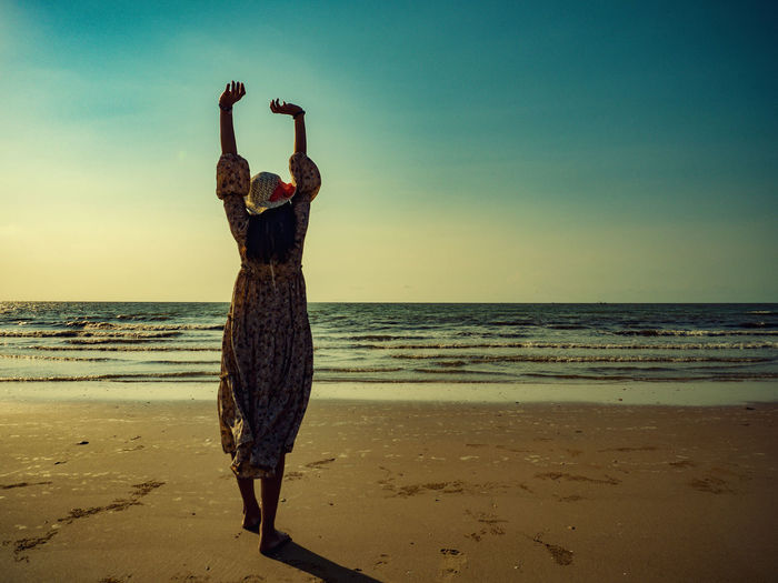This summer, let's go to the sea. Sea Beach Sky Horizon Land Horizon Over Water Water Scenics - Nature Sand Beauty In Nature Nature Tranquil Scene Tranquility Real People Leisure Activity Rear View Full Length Lifestyles Arms Raised Human Arm Outdoors