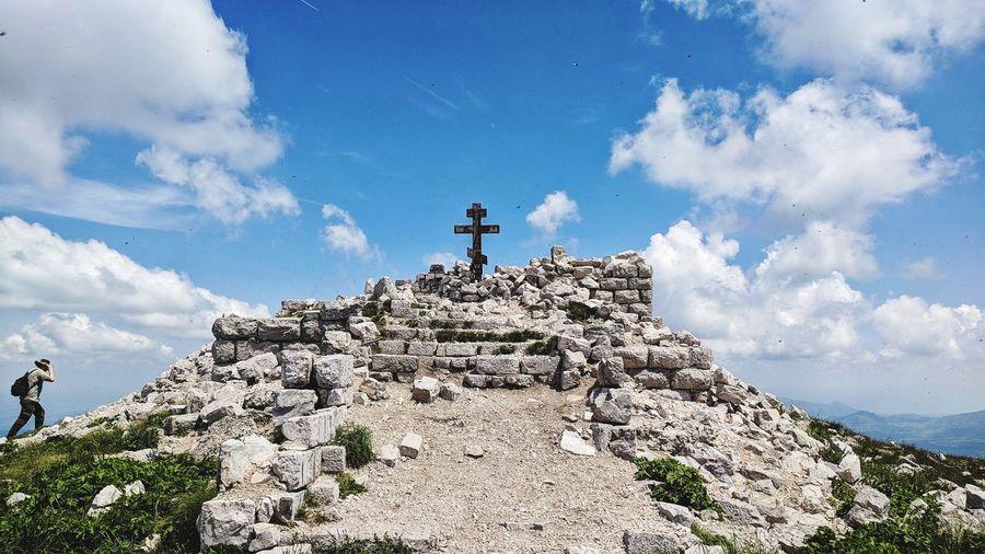 Hiking on the top of the Rtanj mountain EyeEm Selects Orthodox Cross Serbia Rtanj šiljak Adventure Full Length Men Hiking Mountain Peak Standing Rock - Object Blue Sky Mountain Climbing Rock Climbing Hiker Mountain Range Climbing