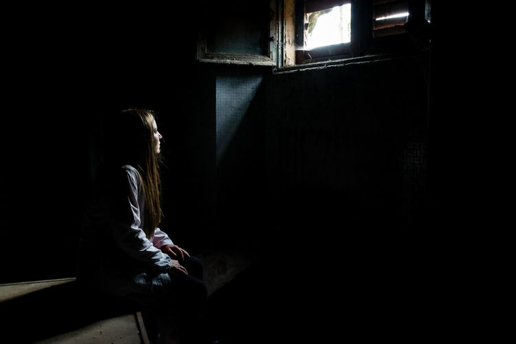 Way out Abandoned Places IndoorPhotography Light Lights Shadows & Lights Abandoned Architecture Contemplation Dark Depression - Sadness Emotion Indoors  Indoors  Long Hair One Person Real People Sadness Shadows Sitting Window Windows Women